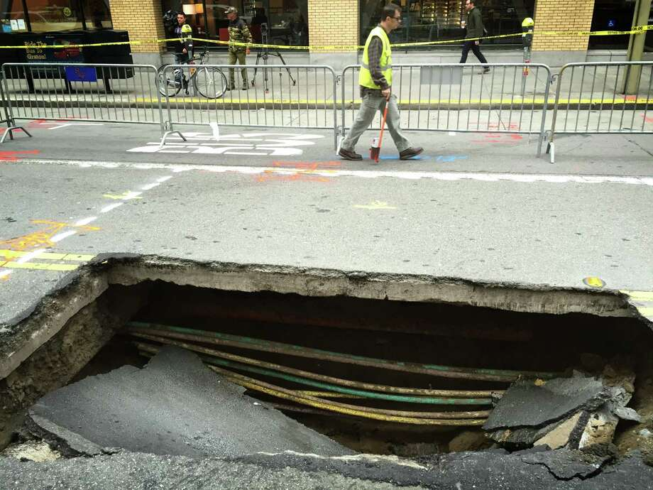Crews with the San Francisco Public Utilities Commission worked Wednesday to repair a sinkhole on Mission Street between New Montgomery and Second streets. Photo: Evan Sernoffsky / /
