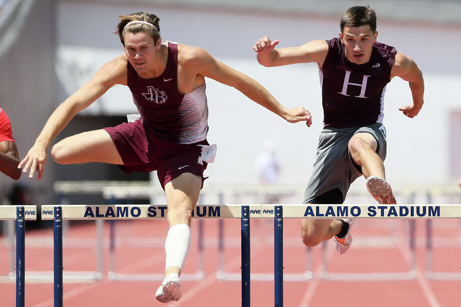Highlands' Chris Hernandez (right) clears the final hurdle in the 300-meter race at the Region IV-5A track and field championships, held late last month. Photo: Marvin Pfeiffer /San Antonio Express-News / Express-News 2016