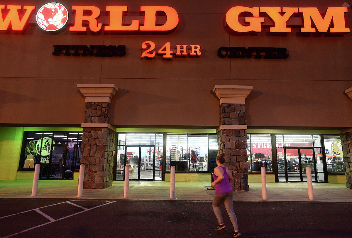 A woman jogs to the entry as members work out at World Gym in Beaumont Monday night. Photo taken Monday, May 9, 2016 Kim Brent/The Enterprise