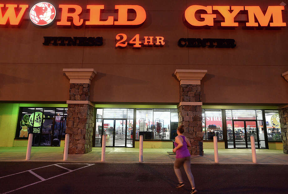 A woman jogs to the entry as members work out at World Gym in Beaumont Monday night. Photo taken Monday, May 9, 2016 Kim Brent/The Enterprise Photo: Kim Brent / Beaumont Enterprise