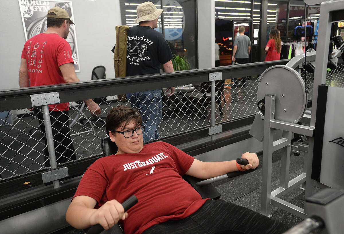 Brandon Perez does reps on the equipment as members work out at World Gym in Beaumont Monday night. Photo taken Monday, May 9, 2016 Kim Brent/The Enterprise