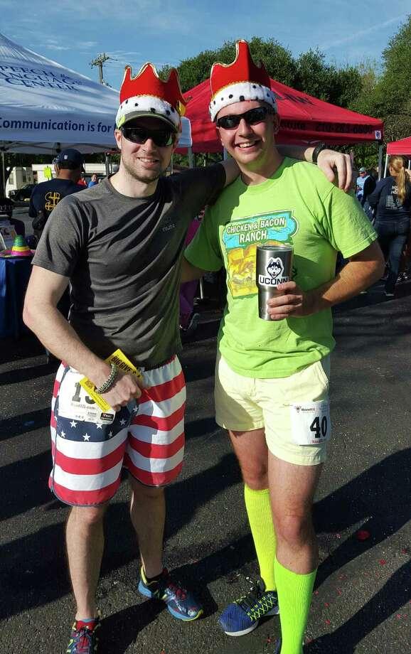 Runners David Brandl (left) and Steve Paniati take a break after competing in Saturday's Fiesta Especial 5K run in Windcrest. Photo: Jeff B. Flinn / Northeast Herald