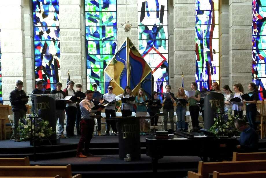 Cantor Asa Fradkin and the Temple Sholom Teen Choir rehearse an original piece composed by Cantor Gerald Cohen, in preparation for the synagogue's Centennial Concert on May 15, 2016.