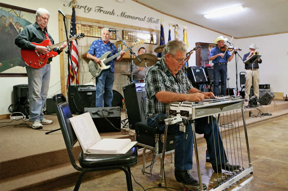 Roger Edgington is featured on steel guitar with Ben Price (from left), Jim Cleckler, Lonnie Castleman, Jim Boledo, Kenny Piper and Dean Schilling behind him during the San Antonio Steel Guitar Association's monthly jam session at American Legion Post 593 in Converse on Sunday, May 1, 2016.  MARVIN PFEIFFER/ mpfeiffer@express-news.net Photo: Marvin Pfeiffer, Staff / San Antonio Express-News / Express-News 2016