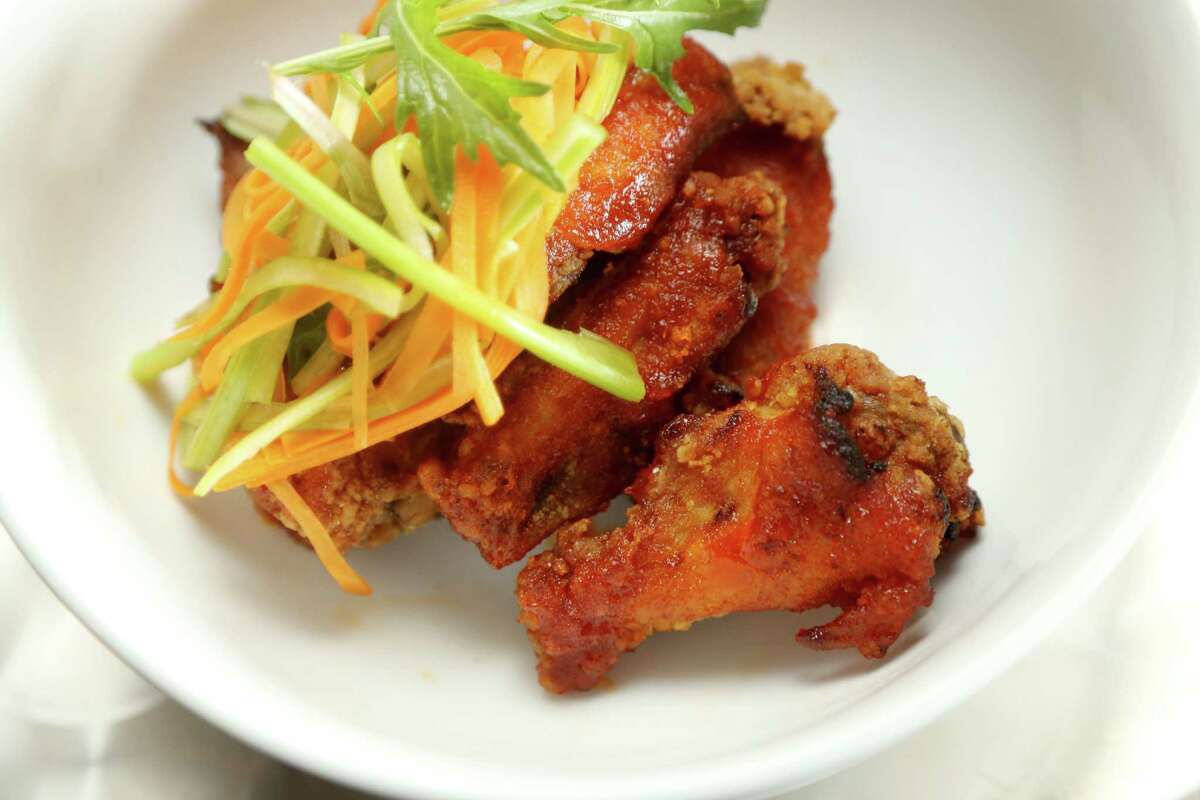 Sweet and spicy wings; crispy wings with Valentina hot sauce and local honey, at Harold's Tap Room.