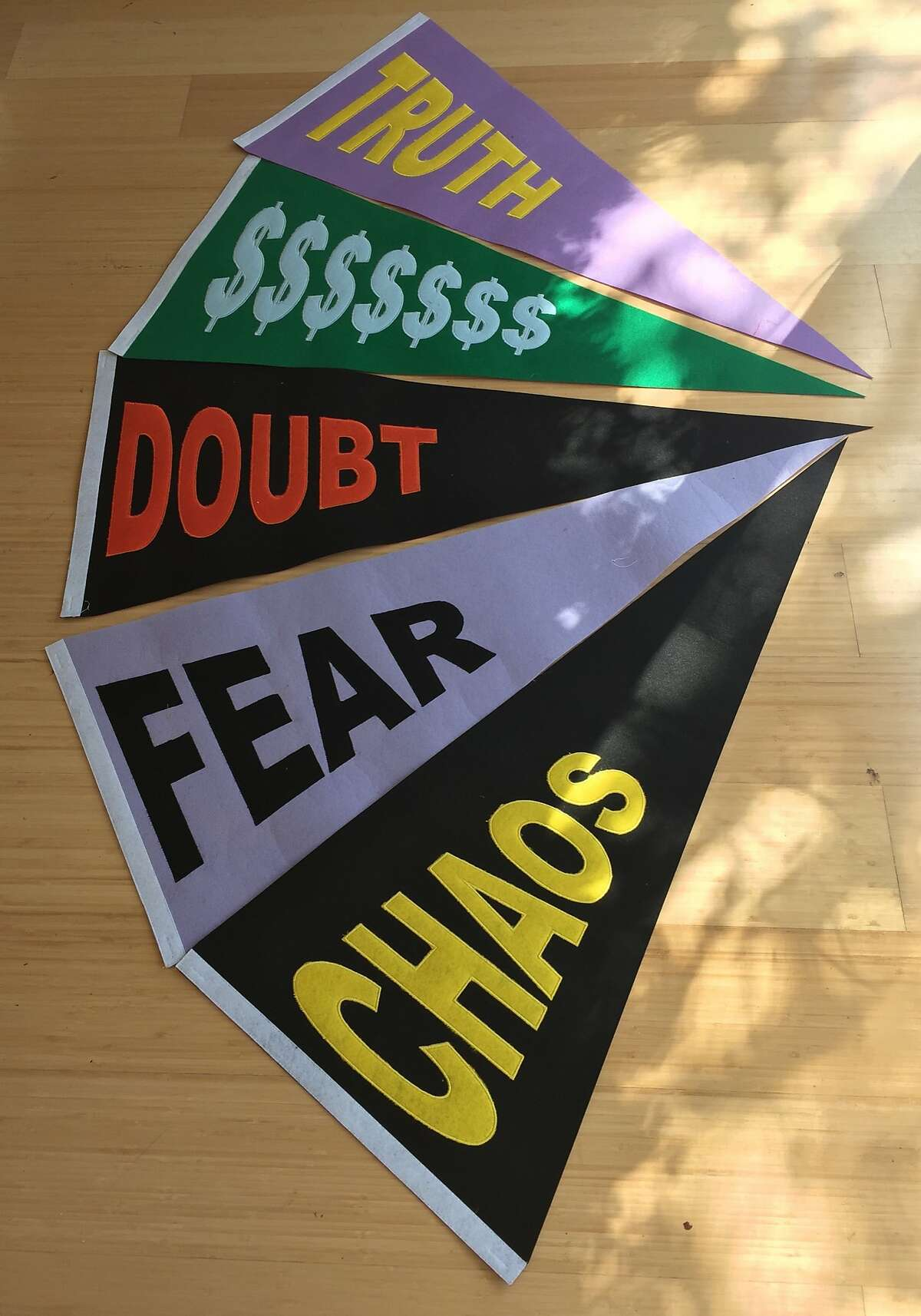 """Pennants by Michael Krause, part of the exhibition """"Welcome to the Left Coast"""" at the Luggage Store Gallery, May 13-June 1."""