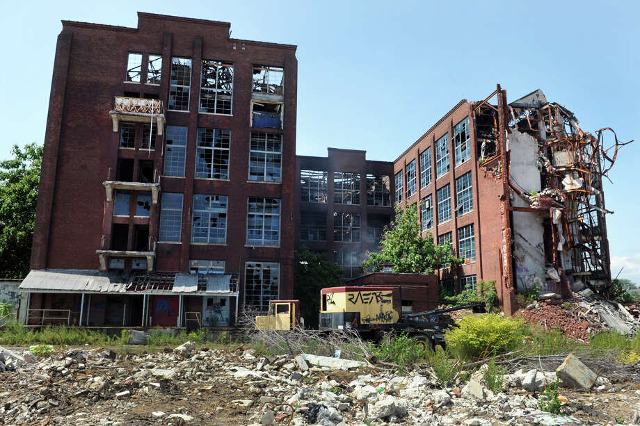 The former Remington Arms plant on Barnum Avenue along the Metro-North Railroad tracks, in Bridgeport, Conn. Photo: Ned Gerard / Ned Gerard / Connecticut Post