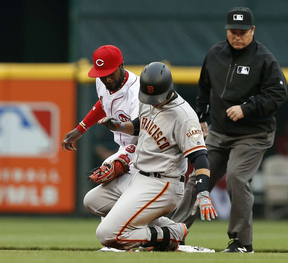 Buster Posey slides into second with a double in Cincinnati on May 3. He has been hitless in all but one game since. Photo: Gary Landers, Associated Press