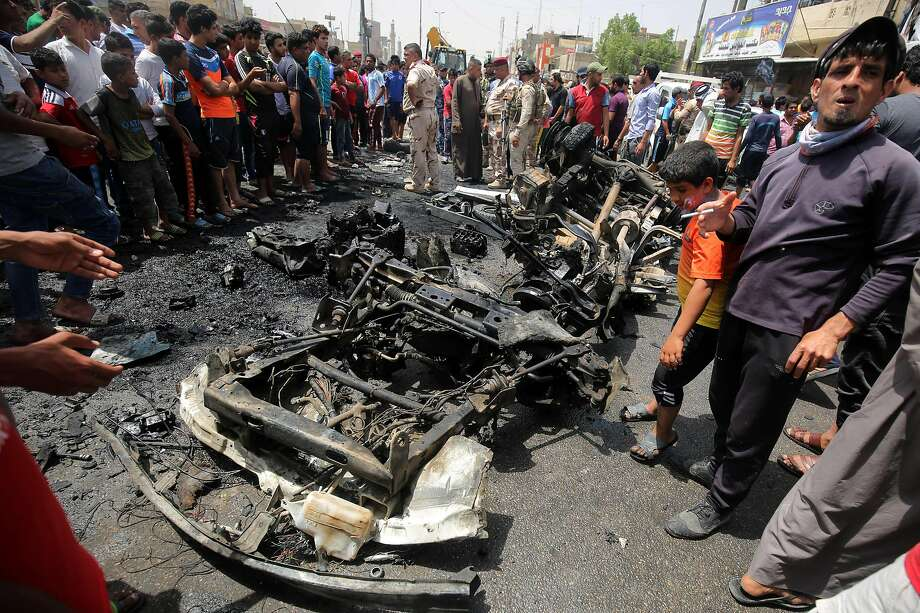 Residents look at wreckage after an Islamic State attack in Sadr City, a Shiite area north of Baghdad. Photo: AHMAD AL-RUBAYE, AFP/Getty Images