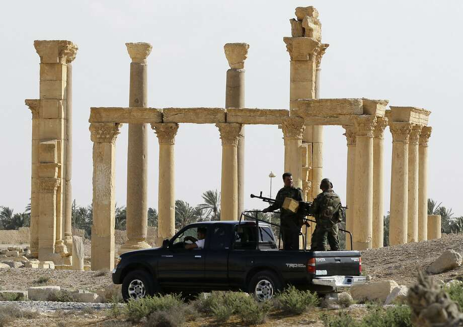 The Syrian army patrols the ancient city of Palmyra a UNESCO world heritage site. Photo: LOUAI BESHARA, AFP/Getty Images