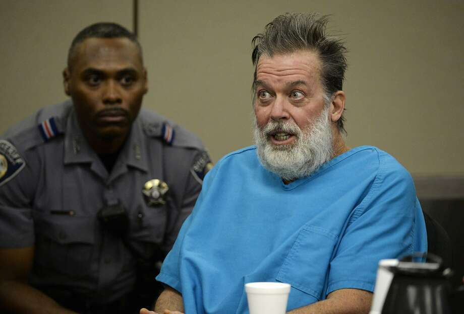 FILE - In this Dec. 9, 2015 file photo, Robert Lewis Dear talks to Judge Gilbert Martinez during a court appearance in Colorado Springs, Colo. The judge is set to rule on the mental state of Dear who acknowledged killing three people at a Planned Parenthood clinic in Colorado. Martinez is expected to announce Wednesday, May 11, 2016, whether criminal proceedings should continue against 57-year-old Dear. (Andy Cross/The Denver Post via AP, Pool, File) Photo: Andy Cross, Associated Press