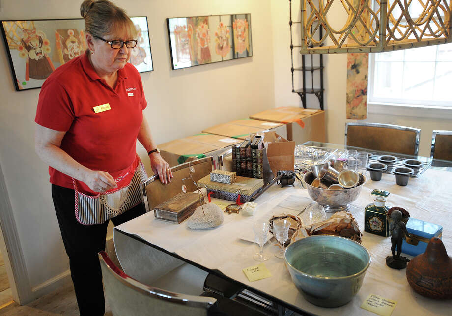 The Settlers employee Andrea Woodworth has items organised for packing at the home of company client Karley Meltzer in Westport, Conn. on Thursday, April 7, 2016. Photo: Brian A. Pounds / Hearst Connecticut Media / Connecticut Post