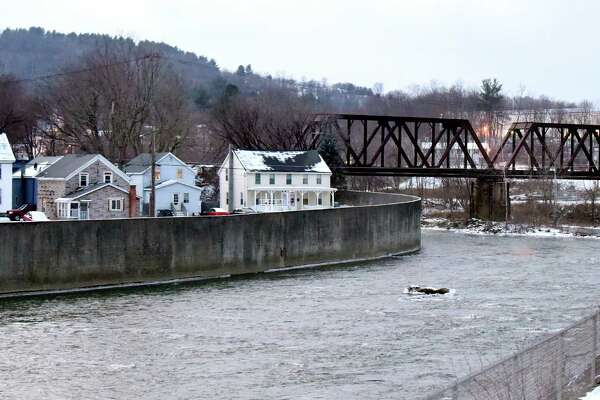 The Hoosic River flows through the village where PFOA contamination is in the water system on Thursday, Jan. 14, 2016, in Hoosick Falls, N.Y. (Cindy Schultz / Times Union)