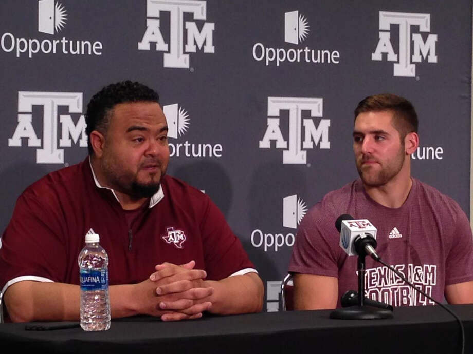 Texas A&M football' player development director Mikado Hinson and quarterback Trevor Knight are part of a group of Aggies heading to Haiti on a mission trip this week. Photo: Brent Zwerneman