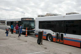 EZ Rider patrons wait change busses Tuesday at the temporary station on the east side of Baird Street. James Durbin/Reporter-Telegram