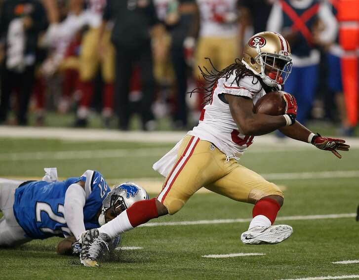DETROIT, MI - DECEMBER 27: DuJuan Harris #32 of the San Francisco 49ers carries the ball during the second quarter while playing the Detroit Lions at Ford Field on December 27, 2015 in Detroit, Michigan. (Photo by Gregory Shamus/Getty Images)