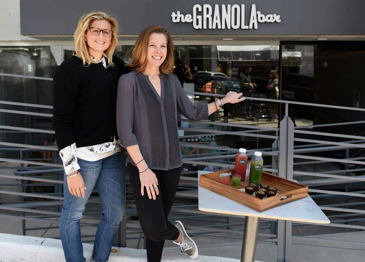 Co-owners Julie Mountain, left, and Dana Noorily pose outside The Granola Bar along Greenwich Avenue in downtown Greenwich, Conn. Monday, May 9, 2016. The new Greenwich location is soon opening in addition to the Westport location that has been open for two years.