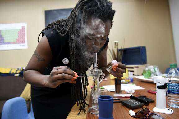Andrea Unsworth, owner of the cannabis delivery service StashTwist,   dabs a hit of live resin at her company's office in Berkeley, CA on May 11th, 2016.