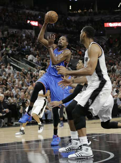 Oklahoma City Thunder forward Kevin Durant (35) drives to the basket past San Antonio Spurs forward Tim Duncan (21) during the first half in Game 5 of a second-round NBA basketball playoff series, Tuesday, May 10, 2016, in San Antonio. (AP Photo/Eric Gay) Photo: Eric Gay, Associated Press