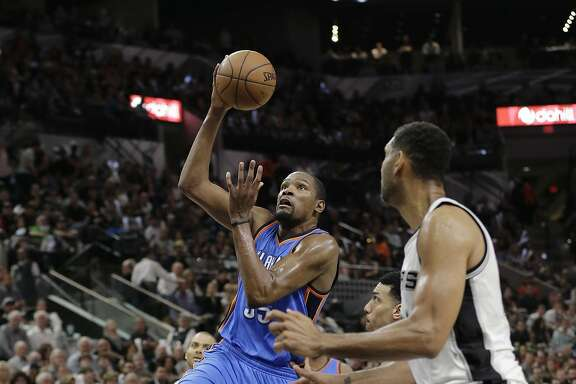 Oklahoma City Thunder forward Kevin Durant (35) drives to the basket past San Antonio Spurs forward Tim Duncan (21) during the first half in Game 5 of a second-round NBA basketball playoff series, Tuesday, May 10, 2016, in San Antonio. (AP Photo/Eric Gay)