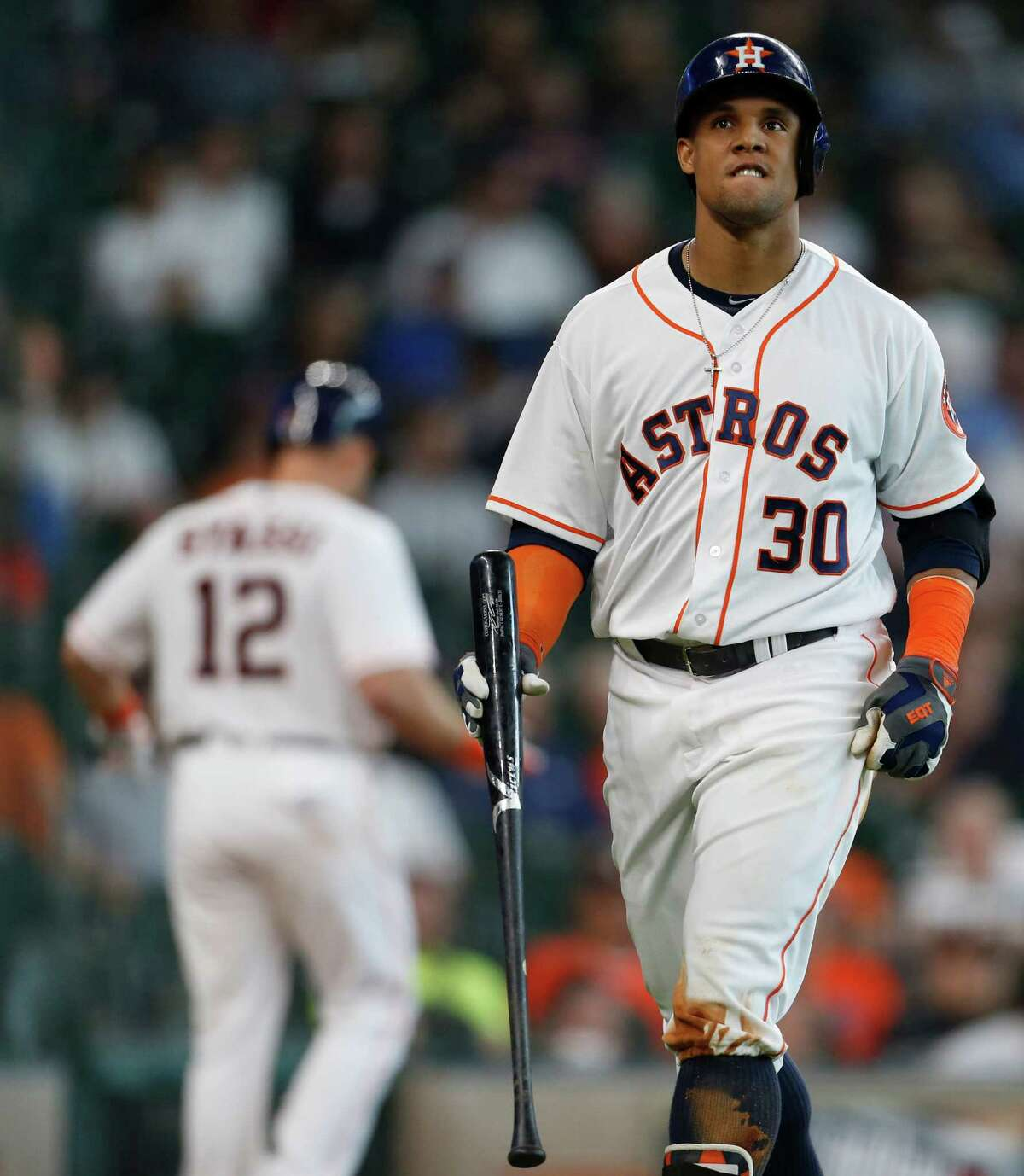Houston Astros center fielder Carlos Gomez (30) reacts after striking out during the third inning of an MLB baseball game at Minute Maid Park, Wednesday, May 11, 2016, in Houston.