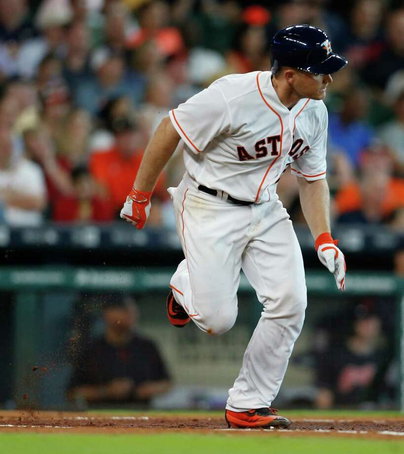 Houston Astros catcher Max Stassi (12) runs to first base as he grounded out during the third inning of an MLB baseball game at Minute Maid Park, Wednesday, May 11, 2016, in Houston. Photo: Karen Warren, Houston Chronicle / © 2016 Houston Chronicle