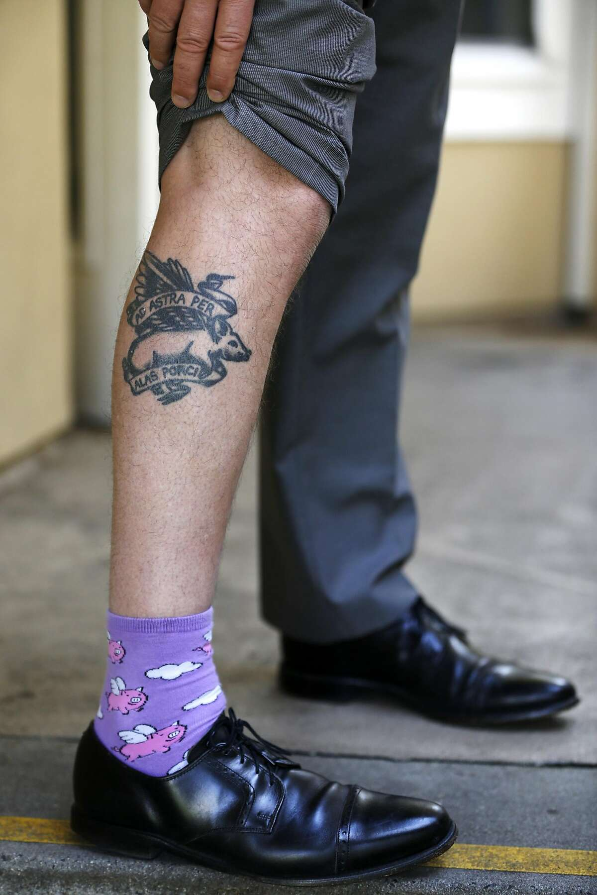 """Jeff Kositsky, director of the new Department of Homelessness and Supportive Housing, shows off his flying pig socks and tattoo, which reads """"to the stars on the wings of a pig,"""" in San Francisco, California, on Wednesday, May 11, 2016."""