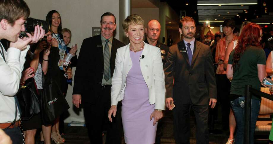 Barbara Corcoran, center, famed NYC real estate broker and star of the ABC investor show Shark Tank, center, on the way to the stage to speak at the Champions School of Real Estate's Keynote 2016 Houston event.  (For the Chronicle/Gary Fountain, May 11, 2016) Photo: Gary Fountain, Gary Fountain/For The Chronicle / Copyright 2016 by Gary Fountain