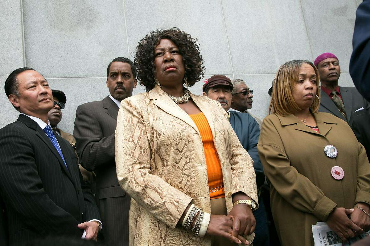 L-R: Public defender Jeff Adachi, Felicia Jones, with the Justice 4 Mario Woods Coalition, and Woods' mother Gwen listen in and wait to speak during a news conference outside the Hall of Justice on Wednesday, May 11, 2016 in San Francisco, Calif.