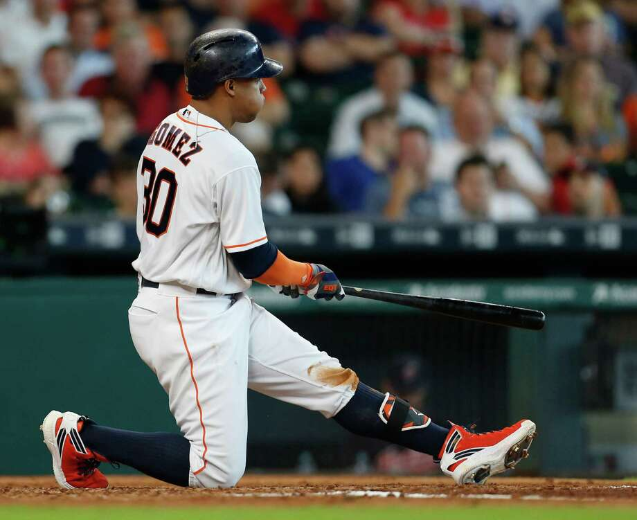 Houston Astros center fielder Carlos Gomez (30) kneels on the ground after swinging at a pitch during the fifth inning of an MLB baseball game at Minute Maid Park, Wednesday, May 11, 2016, in Houston. Photo: Karen Warren, Houston Chronicle / © 2016 Houston Chronicle