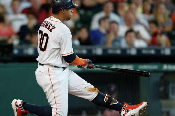 Houston Astros center fielder Carlos Gomez (30) kneels on the ground after swinging at a pitch during the fifth inning of an MLB baseball game at Minute Maid Park, Wednesday, May 11, 2016, in Houston.