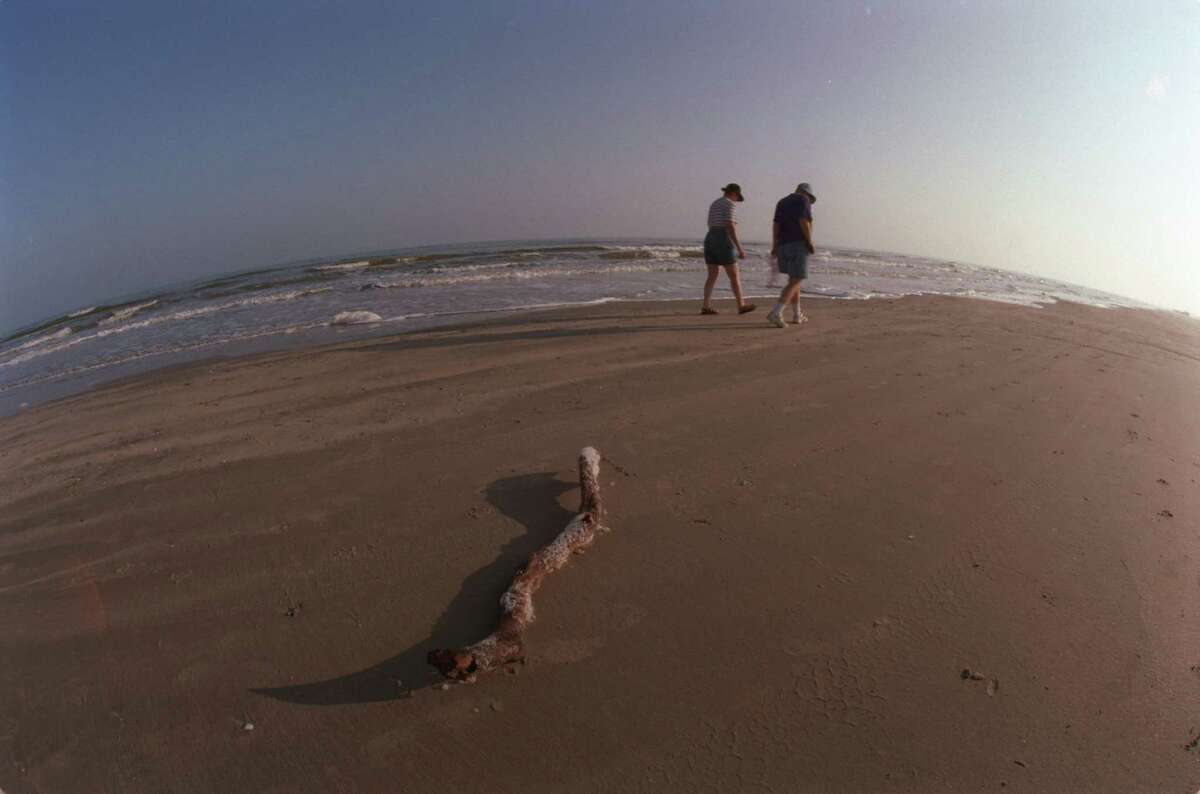 Walking along the beach on Mustang Island are Peggy Burr and Bonnie Ramoie -- winter Texans.
