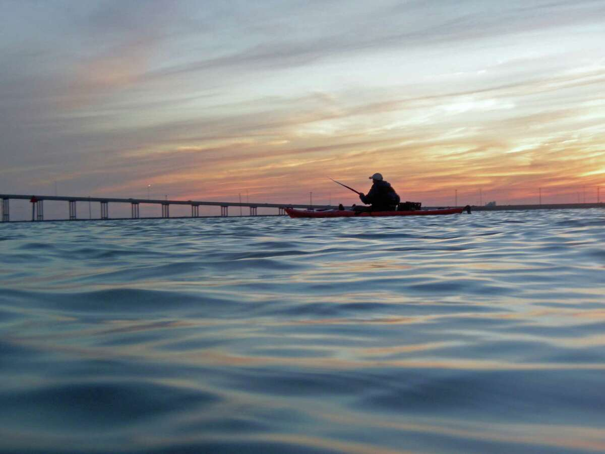 Dean Thomas wraps up a day of kayak fishing along the Lighthouse lakes and Mustang Island.