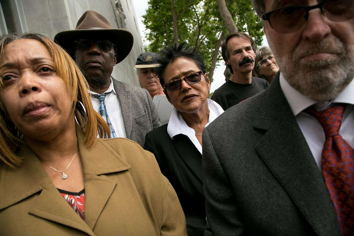 L-R: Gwen Woods, who is the mother of Mario Woods; civil rights lawyer Charles Bonner; Elaine Brown, the former head of the Black Panther Party; and ACLU legal director Alan Schlosser, listen in and wait to speak during a news conference outside the Hall of Justice on Wednesday, May 11, 2016 in San Francisco, Calif.