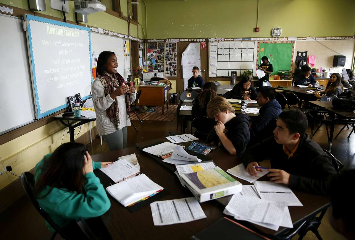 Kamaria Carnes of Teach for America teaches in front of her 8th grade English Language Arts class at Everett Middle School in San Francisco, California, on Wednesday, May 11, 2016.
