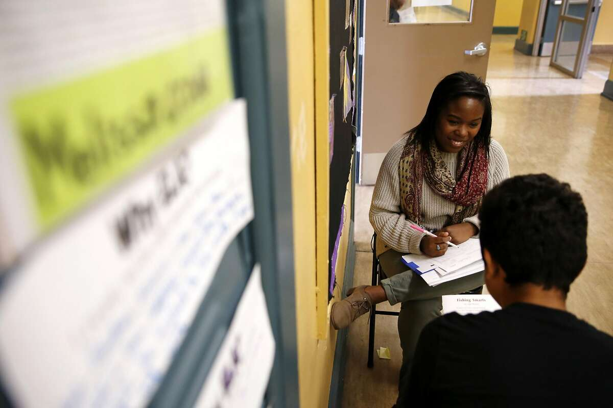 Kamaria Carnes of Teach for America administers an oral exam to Anderson Agular during her 8th grade English Language Arts class at Everett Middle School in San Francisco, California, on Wednesday, May 11, 2016.