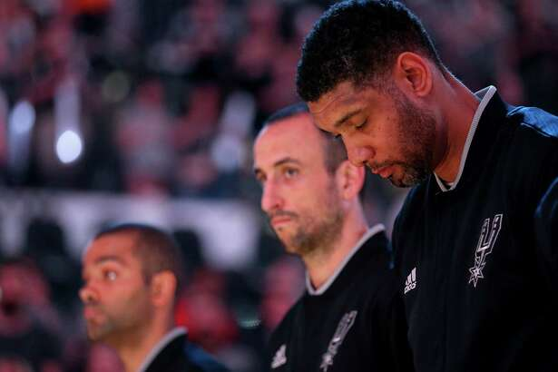 San Antonio Spurs' Tony Parker (from left), Manu Ginobili, and Tim Duncan stand during the national anthem before Game 5 in the Western Conference semifinals against the Oklahoma City Thunder on May 10, 2016 at the AT&T Center.