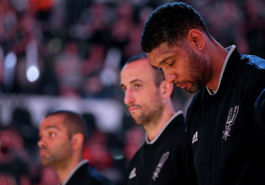 Spurs' Tony Parker (from left), Manu Ginobili, and Tim Duncan stand during the national anthem before Game 5 in the Western Conference semifinals against the Oklahoma City Thunder on May 10, 2016 at the AT&T Center. Photo: Edward A. Ornelas /San Antonio Express-News / © 2016 San Antonio Express-News