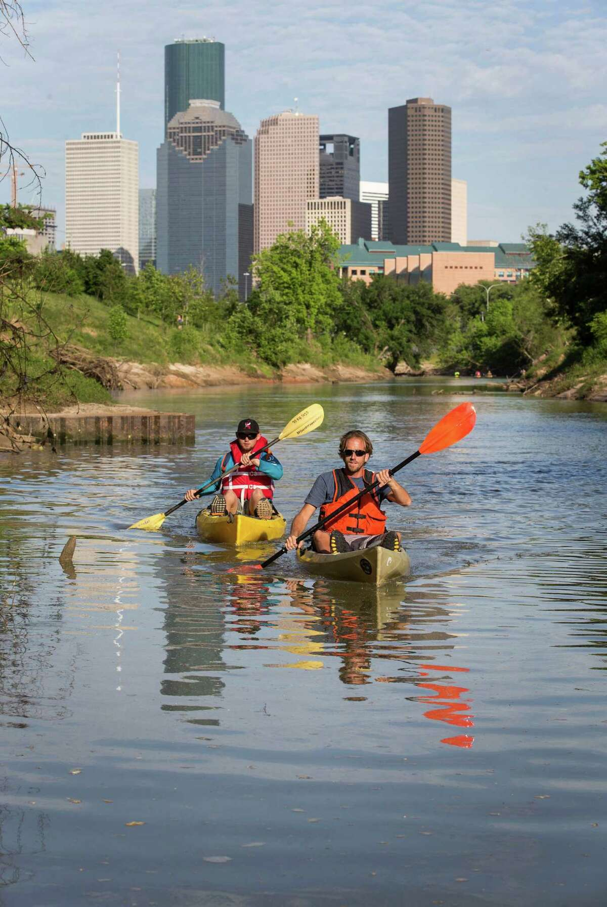 Justin Musgraves, left, and Nick Ellis, kayak on Buffalo Bayou during a photo shoot Friday, April 8, 2016, in Houston. ( Jon Shapley / Houston Chronicle )