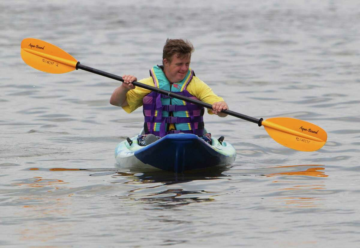 Kendall Parrish kayaks during the Moody Gardens Adaptive Water Sports Festival at Moody Gardens' Palm Beach Marina Saturday, Sept. 8, 2012, in Galveston. ( James Nielsen / Chronicle )