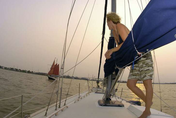 Cindy M. McDaniel on a 42-foot Pearson ketch sailboat used by the Bay Area Sailing School in Galveston Bay near Kemah's Boardwalk, Monday July 19, 2004. FOR ULTIMATE HOUSTON. (Karen Warren/Houston Chronicle)