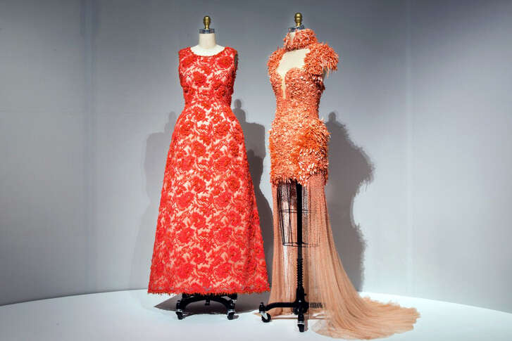 A Hubert de Givenchy 1963 haute couture hand-sewn and embroidered lace gown, left, and a 2012 ready-to-wear gown both hand-sewn and machine made, by Sarah Burton for Alexander McQueen. MUST CREDIT: Metropolitan Museum of Art