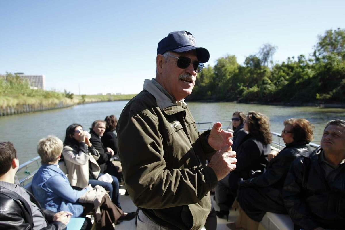 Historian Louis F. Aulbach leading a media tour aboard the Buffalo Bayou Partnership's pontoon tour boat called the Spirit of the Bayou.