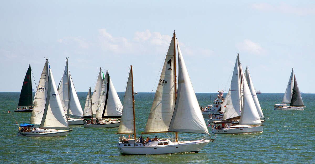 Sailboats depart Galveston kicking off the the Harvest Moon Regatta.
