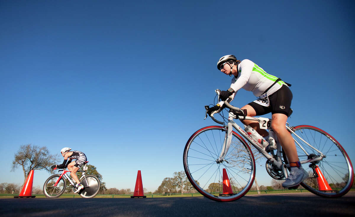 Brian Salin, left, and Dawn Martinez, right, compete in the bike portion of the Du the Polar Bear Duathlon at Bear Creek Park Saturday, Feb. 25, 2012, in Houston. The duathlon consisted of a 3-mile run, a 15-mile bike ride followed by a 2-mile run.(Cody Duty / Houston Chronicle)