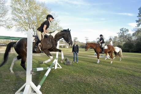"With Kendall Sill (15-year-old 9th grader at Episcopal H.S) jumping with ""Otto"" at left - Merrily Quincoces offers riding lessons at the Houston Polo Club Wednesday 2/27/13. At right is Cristina Jordan (13-year-old 7th grader at Spring Branch Middle School) atop ""Hanna"" and behind her is Gavi Silverman (14-year-old 8th grader at Awty International School) atop ""Toby"". Photo  by Tony Bullard."