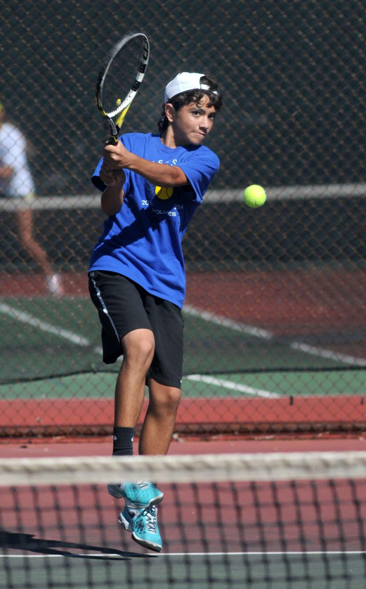 Daniel Mehralizadeh works during a singles match at Memorial Park.