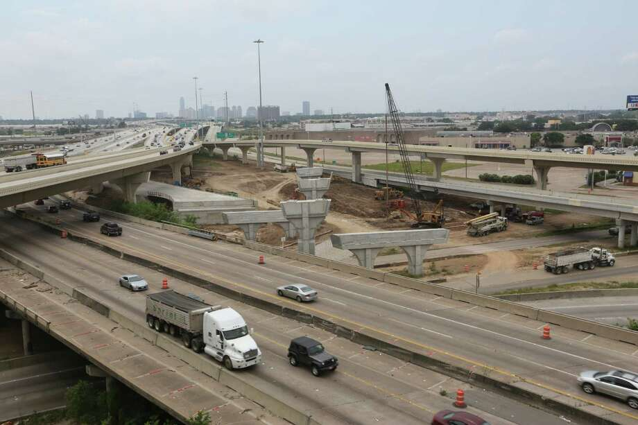 An overview of the construction from northbound Loop 610 to westbound U.S. 290  on May 11. Workers are rebuilding the interchange, as well as widening U.S. 290 to Waller County. Photo: Houston Chronicle / © 2016 Houston Chronicle