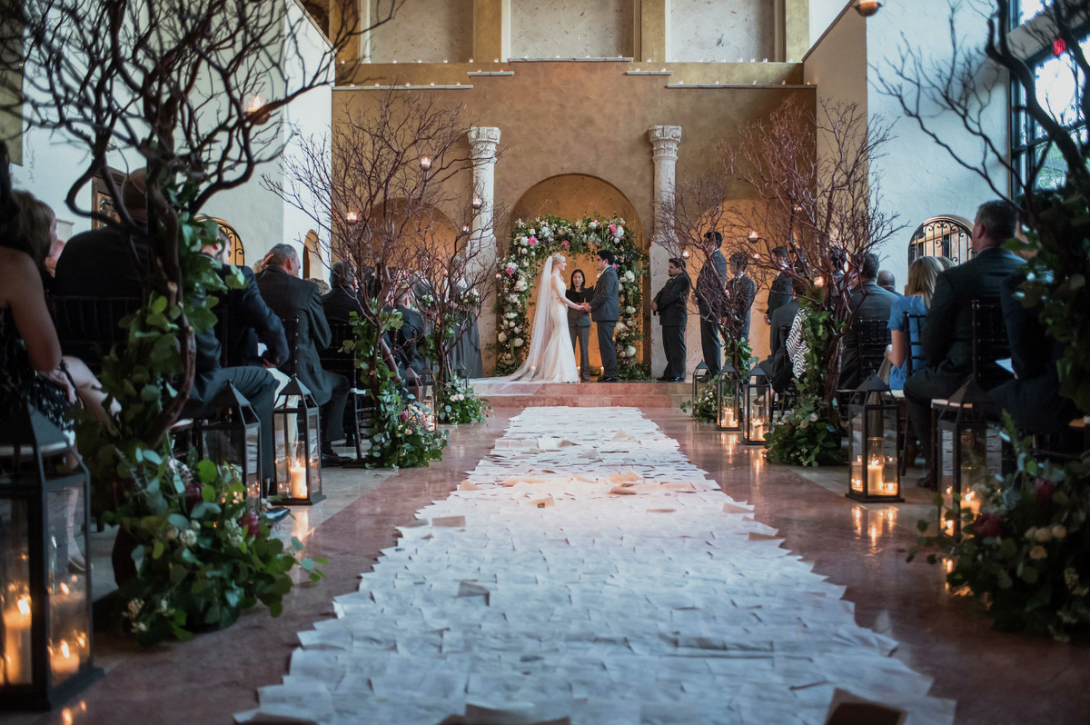 Stephanie Dodd walked down an aisle made from pages from used J.K. Rowling's Harry Potter novels. Aligning the aisle were branches, moss, candles and flowers to complete the Forbidden Forest creation.