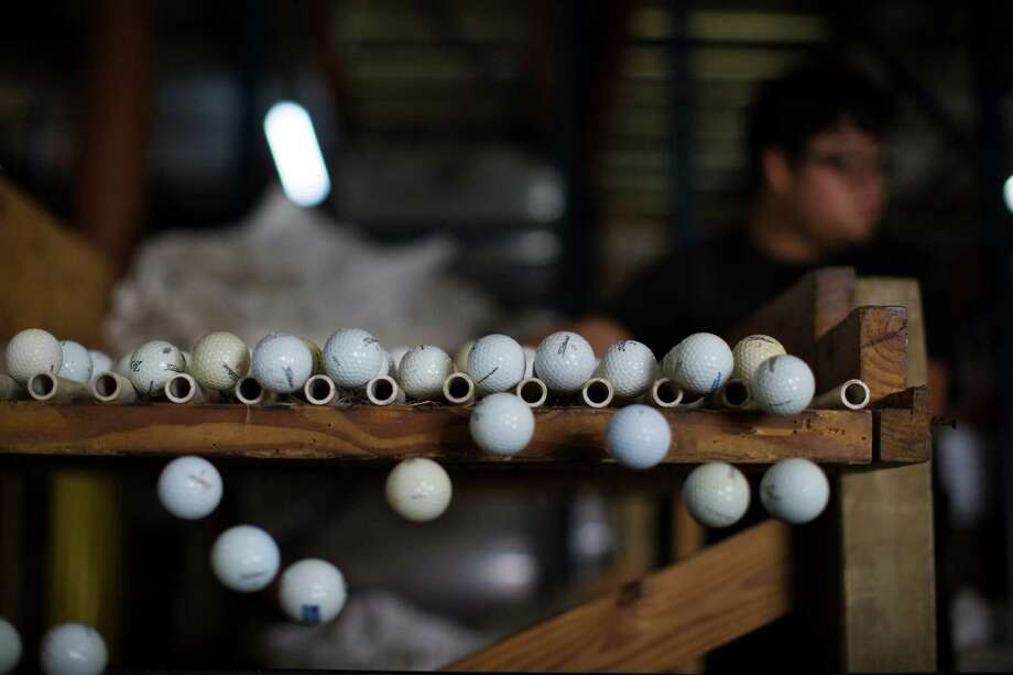 Golf balls get sorted in the warehouse of PG Professional Golf which is the largest supplier of recycled and refinished golf balls in the world. Photo: Marie D. De Jesus /Houston Chronicle / © 2016 Houston Chronicle